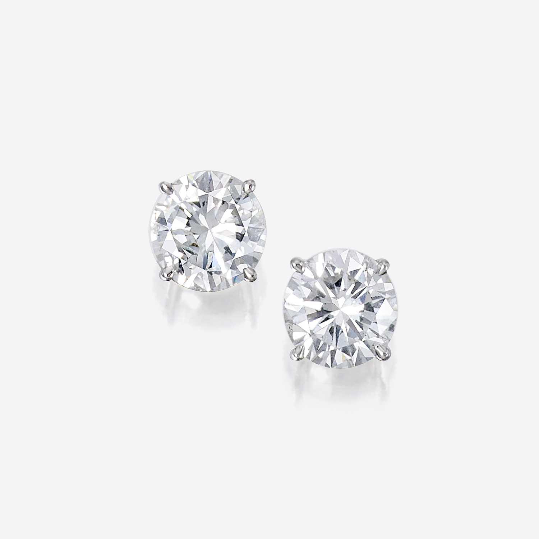 Lot 87 - A pair of diamond and eighteen karat white gold stud earrings
