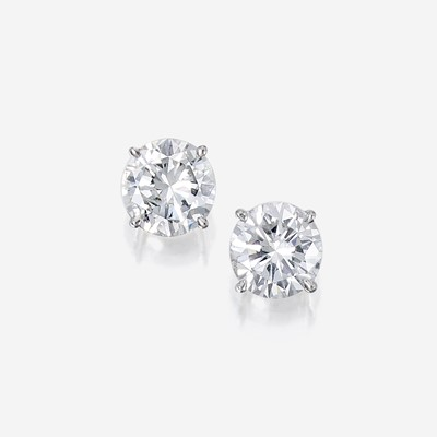 Lot 87 - A pair of diamond and eighteen karat white gold stud earrings