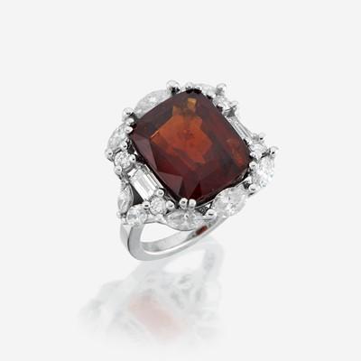 Lot 103 - A garnet, diamond, and eighteen karat white gold ring