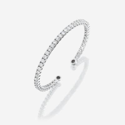 Lot 65 - A diamond and fourteen karat white gold cuff bangle