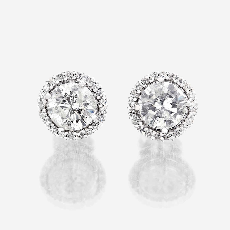 Lot 91 - A pair of diamond and eighteen karat white gold earrings