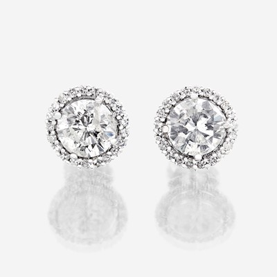 Lot 91 - A pair of diamond and eighteen karat white gold earrings
