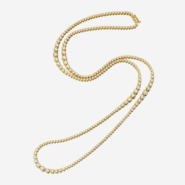 Lot 55 - A diamond and fourteen karat gold necklace