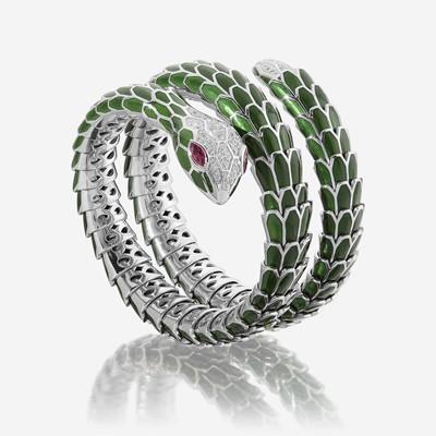 Lot 111 - An enamel, diamond, eighteen karat white gold, and sterling silver bangle