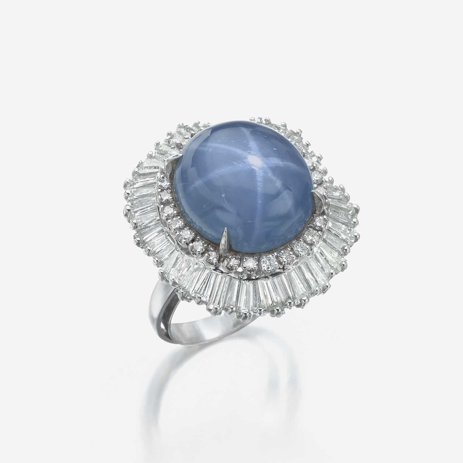 Lot 84 - A star sapphire, diamond, and platinum ring