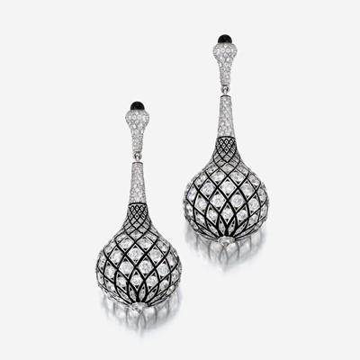 Lot 107 - A pair of diamond, enamel, and eighteen karat white gold ear pendants