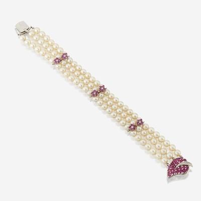 Lot 120 - A cultured pearl, ruby, diamond, and fourteen karat white gold bracelet