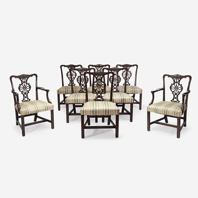 Lot 130 - A set of eight George III style carved mahogany dining chairs