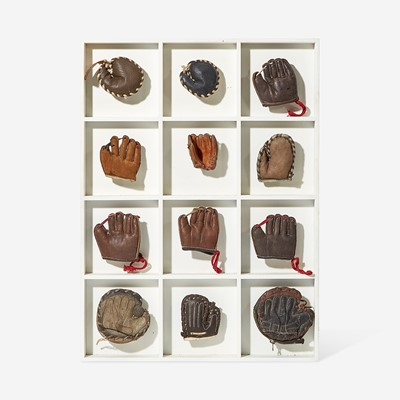 Lot 232 - A collection of twelve miniature leather baseball gloves