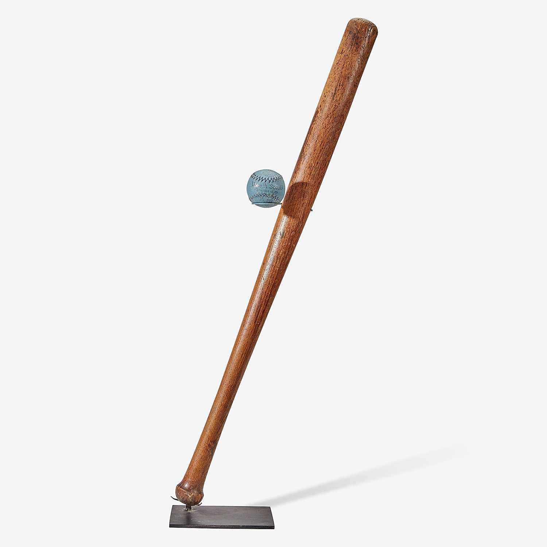 "Lot 239 - A baseball assemblage: mushroom handle bat and ""Worth"" practice ball"
