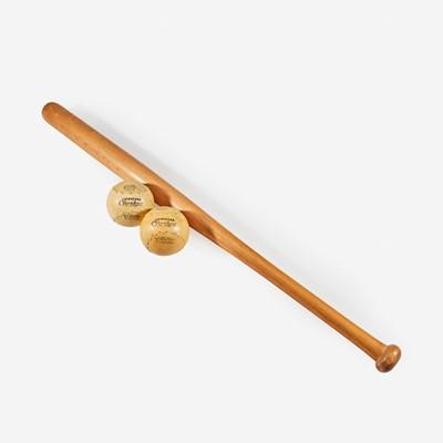 Lot 246 - A baseball assemblage: two oversized bats and three soft balls