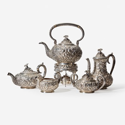"""Lot 179 - A """"Baltimore Rose"""" five-piece sterling silver repoussé tea and coffee service"""