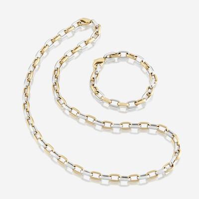 Lot 92 - A bicolor eighteen karat gold necklace and matching bracelet