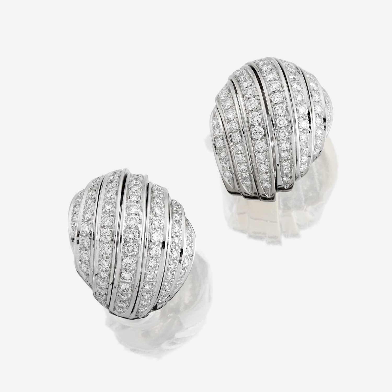 Lot 72 - A pair of eighteen karat white gold and diamond earrings