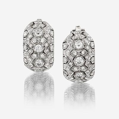 Lot 62 - A pair of eighteen karat white gold and diamond earrings