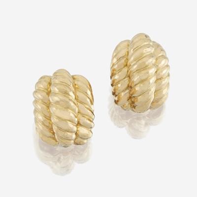 Lot 116 - A pair of eighteen karat gold earrings, David Webb