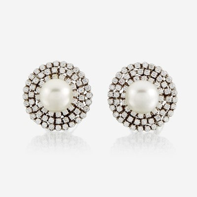 Lot 111 - A pair of cultured pearl, diamond, and eighteen karat white gold earrings