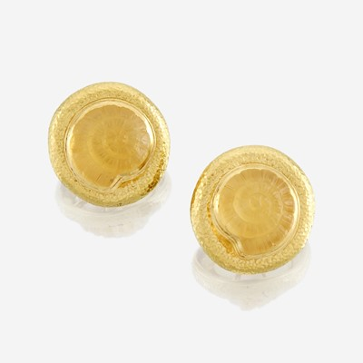 Lot 156 - A pair of carved citrine, eighteen karat gold, and mother of pearl earrings, Elizabeth Gage