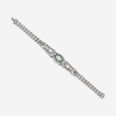 Lot 150 - An Art Deco diamond, emerald, and platinum bracelet
