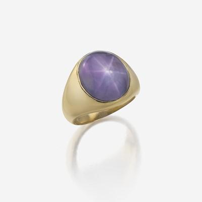 Lot 117 - A star sapphire and fourteen karat rose gold ring, J. E. Caldwell