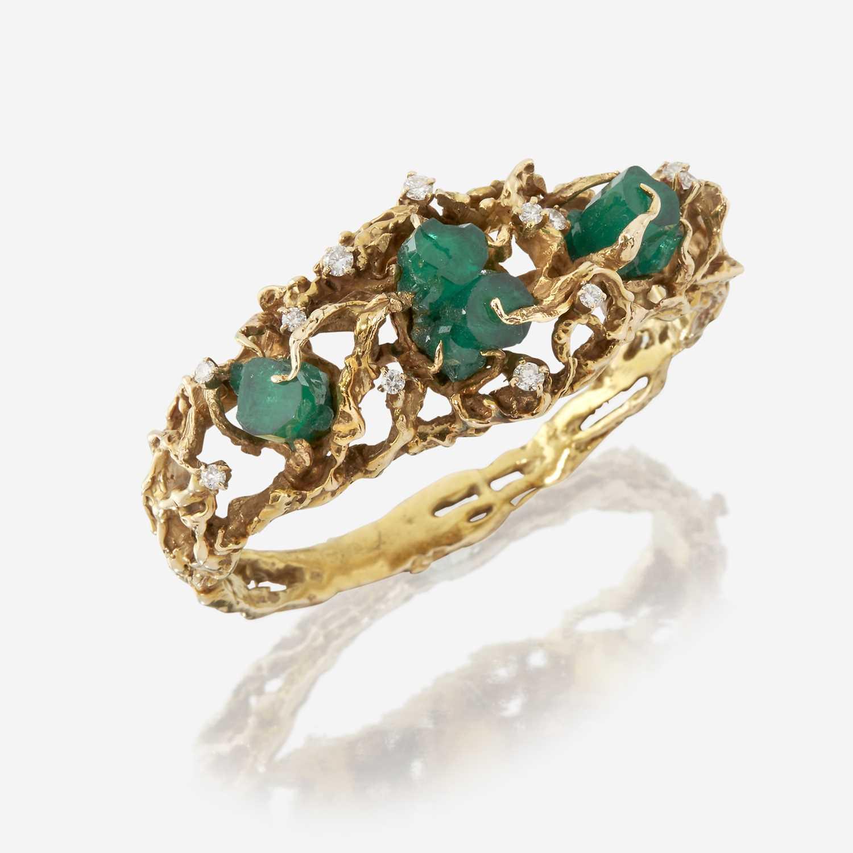 Lot 40 - A fourteen karat gold, green beryl crystal, and diamond bangle