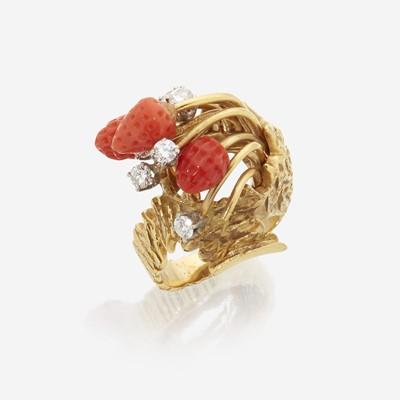 Lot 148 - An eighteen karat gold, coral, and diamond ring