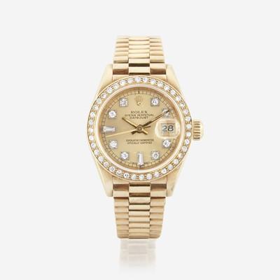 Lot 121 - An eighteen karat gold and diamond, automatic, bracelet wristwatch with date