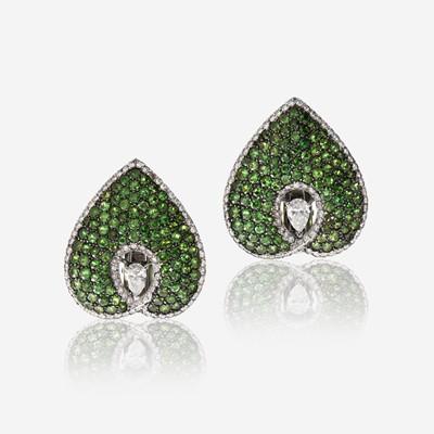 Lot 178 - A pair of diamond, tsavorite garnet, and eighteen karat white gold earclips, David Morris
