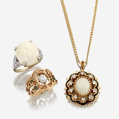 Lot 153 - A collection of three diamond, opal, and gold jewelry pieces