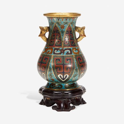 Lot 52 - A Chinese cloisonné archaistic small vase with carved wood stand 掐丝珐琅小樽带底座