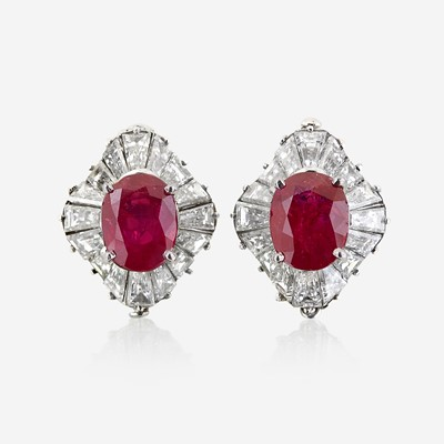 Lot 54 - A pair of diamond and platinum earring jackets with interchangeable ruby and sapphire studs