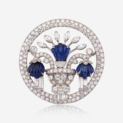 Lot 5 - A diamond, carved sapphire, and platinum brooch, J. E. Caldwell & Co.