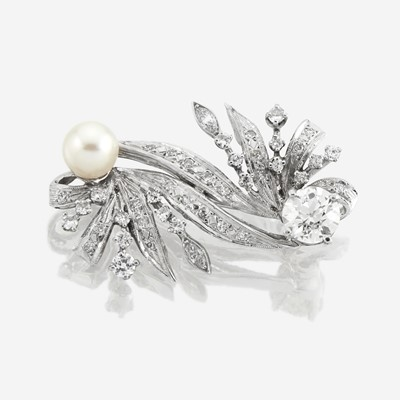 Lot 112 - A fourteen karat white gold, diamond, and cultured pearl brooch
