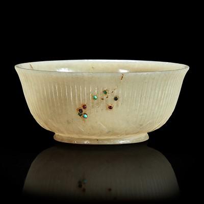 Lot 119 - A Mughal-style embellished greyish jade small bowl 痕都斯坦风格灰玉嵌多宝小碗