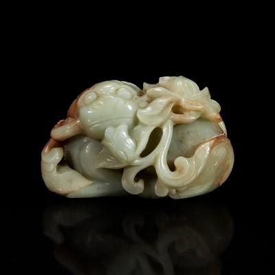 Lot 113 - A Chinese greyish-celadon and russet jade recumbent beast and lotus group 青玉雕瑞兽衔荷花