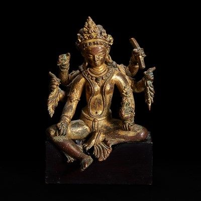Lot 171 - A Nepalese gilt copper alloy figure of Vasudhara 尼泊尔持世菩萨鎏金铜造像