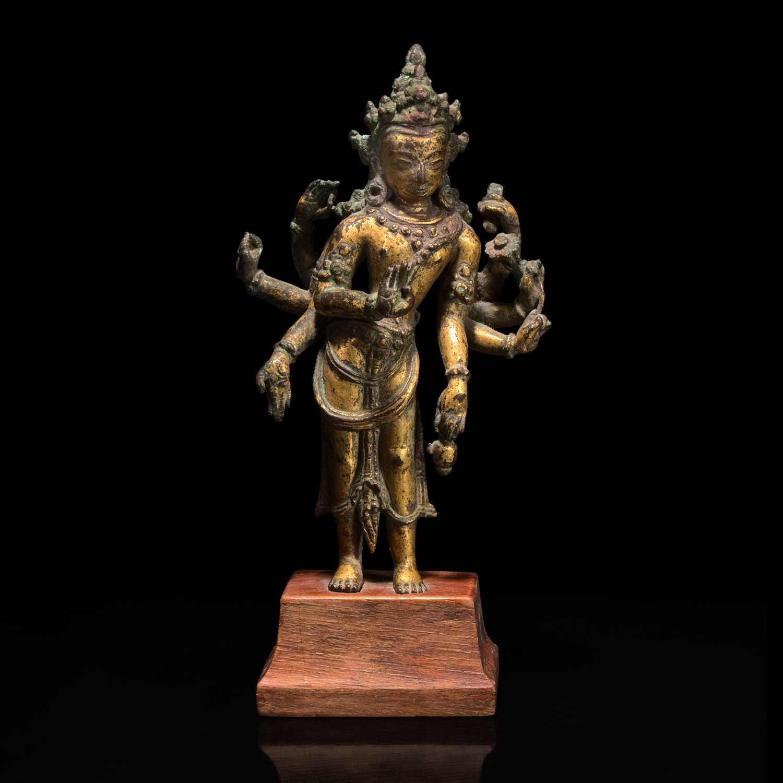 Lot 172 - A Nepalese gilt copper alloy figure of Amoghapasha 尼泊尔六臂观音鎏金铜合金造像