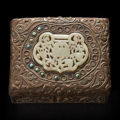 Lot 142 - A Chinese white jade-mounted brass repousse box 嵌玉浮雕铜盒