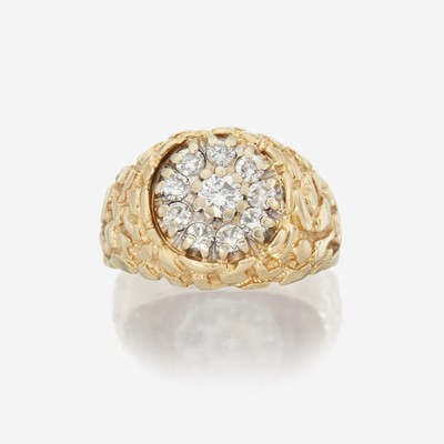 Lot 138 - A fourteen karat gold and diamond ring