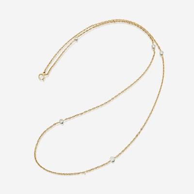 Lot 159 - A fourteen karat gold and diamond necklace