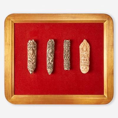 Lot 153 - Two framed collections of Tibetan carved bone apron ornaments 藏传佛教法衣骨片两套