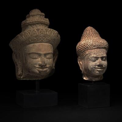 Lot 161 - Two Khmer style carved stone heads 高棉风格石雕佛首两件