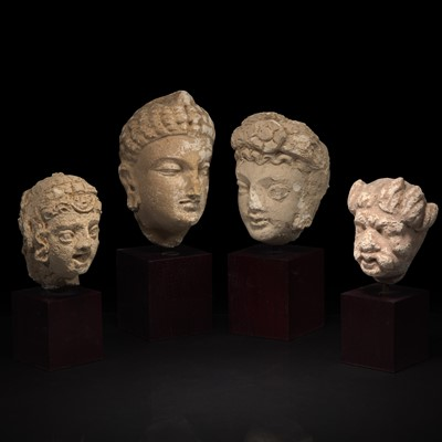Lot 159 - A group of four small stucco heads 石灰岩佛首一组四件