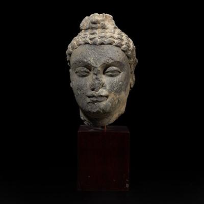 Lot 157 - A carved schist head of a Buddha, Gandhara 健陀罗片岩佛首
