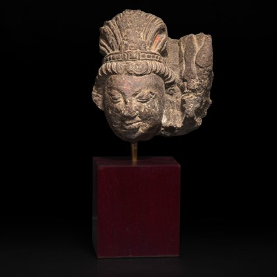 Lot 155 - A carved stone head, possibly Shiva 石雕佛首, 或湿婆神