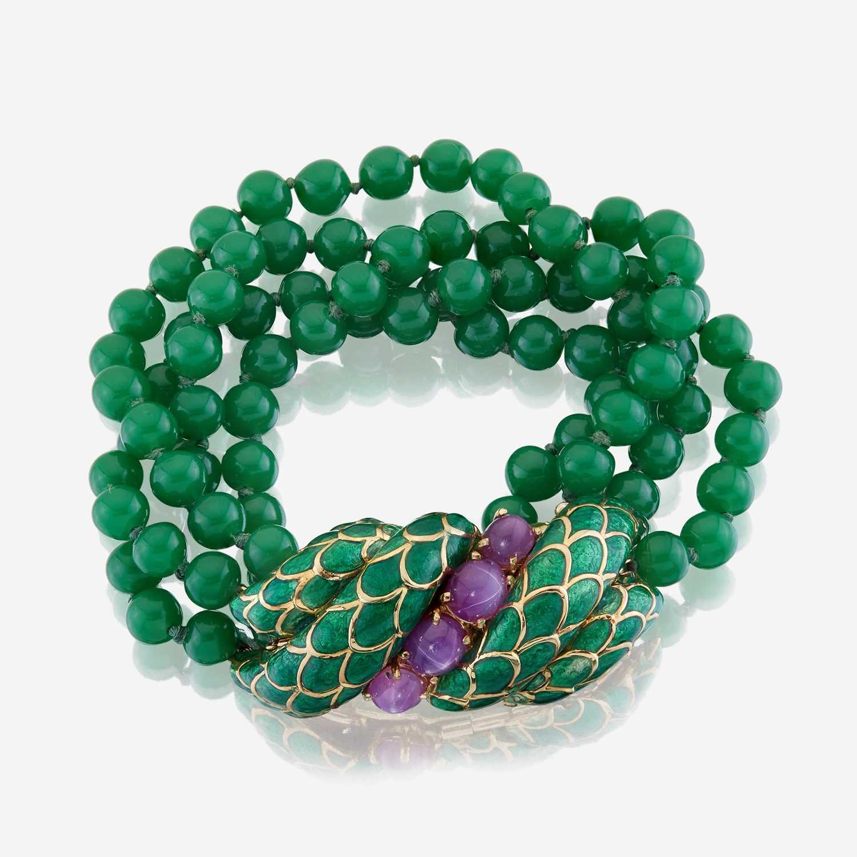 Lot 10 - An eighteen karat gold, enamel, star ruby, and glass bead bracelet, David Webb