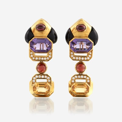 Lot 87 - A pair of eighteen karat gold and gem-set ear pendants