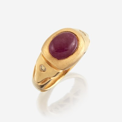 Lot 158 - A twenty-two karat gold, ruby, and colored diamond ring