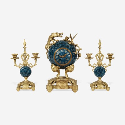 Lot 73 - A Chinese Style Enameled Porcelain and Gilt-Bronze Mounted Clock Garniture