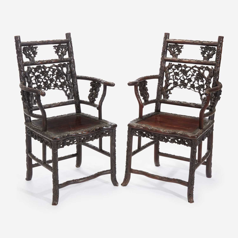 Lot 58 - An unusual pair of Chinese carved hardwood armchairs 中国硬木扶手椅一对